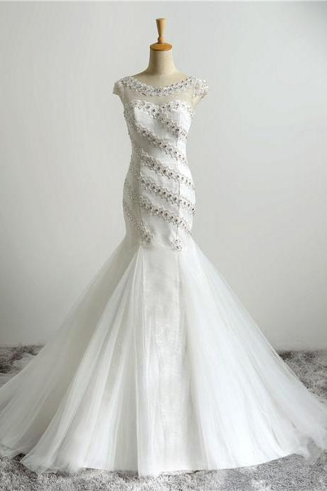 White Floor Length Tulle Mermaid Wedding Gown Showcasing Lace Appliquéd and Beaded Embellished Bateau Illusion Cap Sleeves Bodice and Lace-Up Back