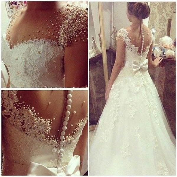 V-Neck Sheer Beaded Lace Appliqués A-line Wedding Dress Featuring Bow Accent
